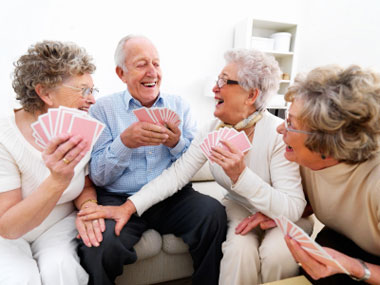 istockphoto_9976075-happy-senior-men-and-women-playing-cards